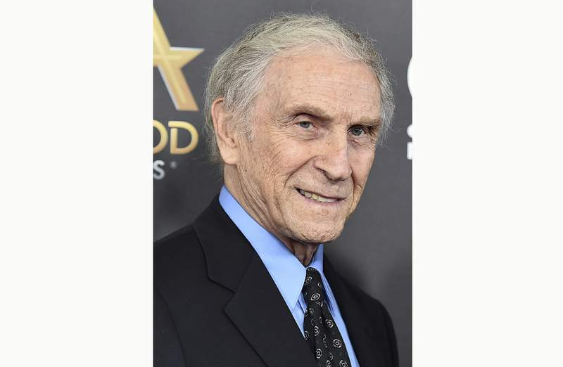 """FILE - In this Nov. 1, 2015, file photo, Peter Mark Richman arrives at the Hollywood Film Awards in Beverly Hills, Calif. Richman, a character actor who appeared in hundreds of television episodes and had recurring roles on Three's Company"""" and Beverly Hills 90210,"""" has died. He was 93. Richman died Thursday, Jan. 14, 2021, at his home in Los Angeles of natural causes, publicist Harlan Boll announced. (Photo by Jordan Strauss/Invision/AP, File)"""