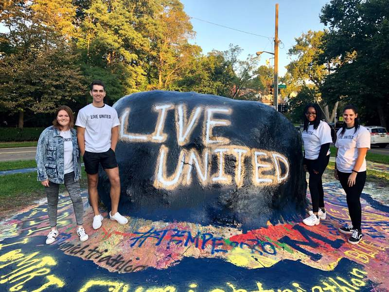 Volunteers stand by The Rock at the University of Michigan in Ann Arbor.