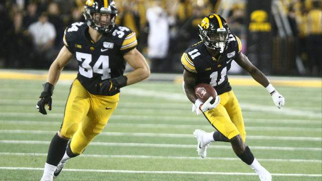 Defensive back Michael Ojemudia #11 of the Iowa Hawkeyes runs back an interception during the second half against the Miami Ohio RedHawks on August 31, 2019 at Kinnick Stadium in Iowa City, Iowa. (Photo by Matthew Holst/Getty Images)