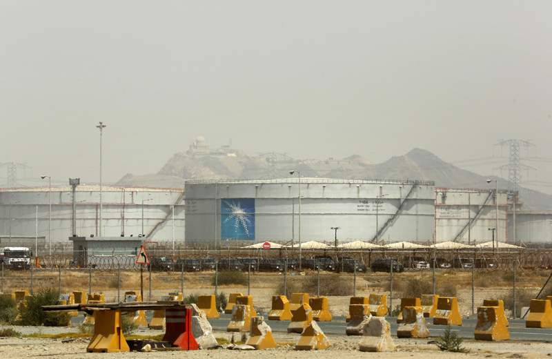 Storage tanks are seen at the North Jiddah bulk plant, an Aramco oil facility, in Jiddah, Saudi Arabia, Sunday, March 21, 2021. Saudi Arabias state-backed oil giant Aramco announced Sunday that its profits nearly halved in 2020 to $49 billion, a big drop that came as the coronavirus pandemic roiled global energy markets. (AP Photo/Amr Nabil)
