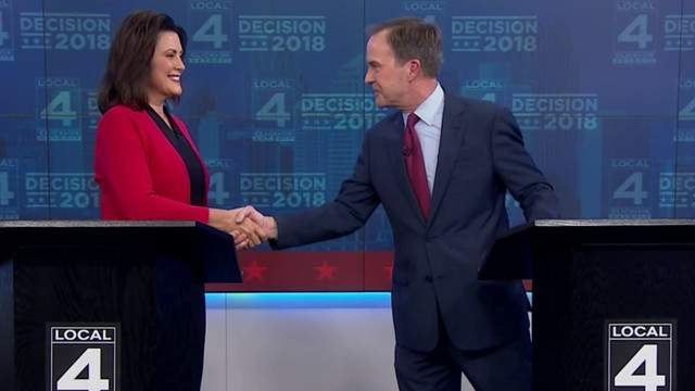 Schuette and Whitmer shake hands at the conclusion of a gubernatorial debate held in Detroit. (WDIV)