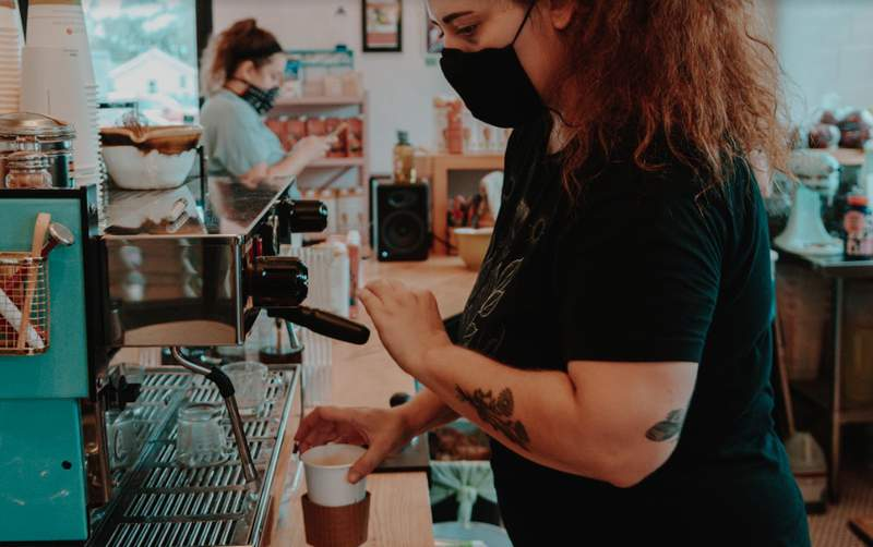 A barista making a espresso based drink at Drifter Coffee.