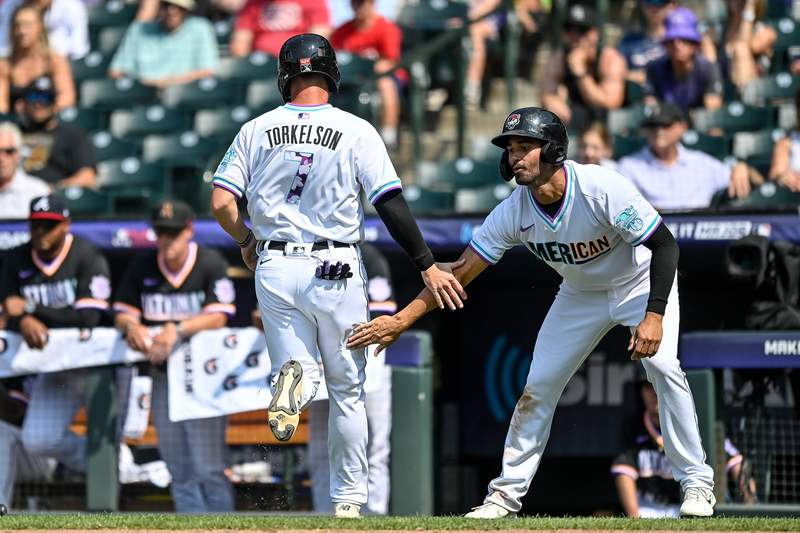 Riley Greene #19 congratulates Spencer Torkelson #7 of the American League Futures Team after both scored against the National League Futures Team in a game at Coors Field on July 11, 2021 in Denver, Colorado.
