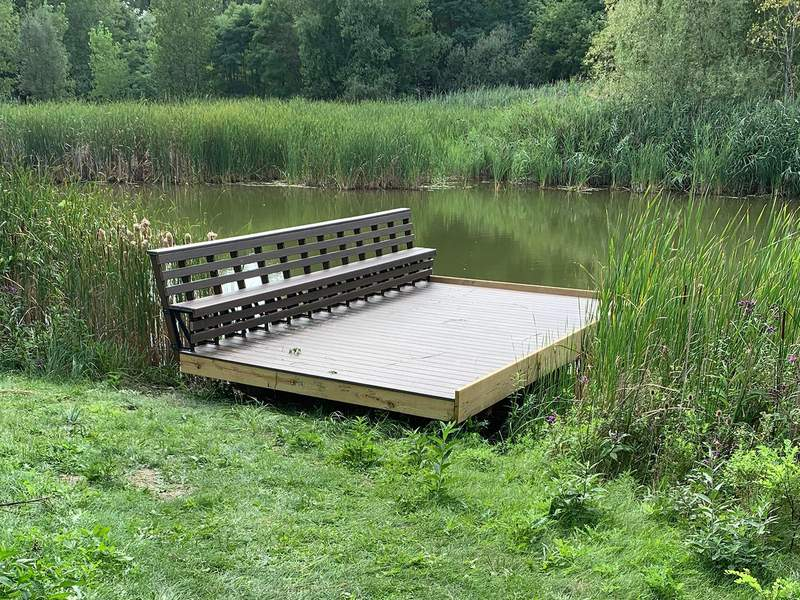 A new dock at Washtenaw Community College, constructed by USA's union volunteers, provides educational and recreational benefits to students, faculty, and the public