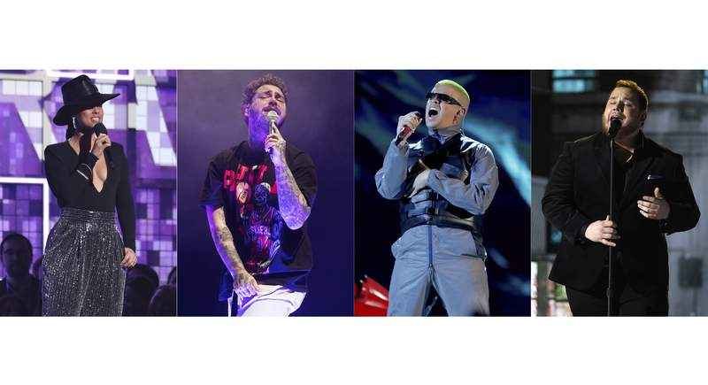 This combination photo shows Alicia Keys hosting the 61st annual Grammy Awards in Los Angeles on Feb. 10, 2019, from left, Post Malone performing in Philadelphia on Feb. 21, 2020, Bad Bunny performing at the Billboard Latin Music Awards in Las Vegas on April 25, 2019 and Luke Combs performing at the 54th annual Academy of Country Music Awards in Las Vegas on April 7, 2019. NBC and dick clark productions announced that Keys, Malone, Bad Bunny and Combs will the perform at the 2020 Billboard Music Awards on Oct. 14.  (AP Photo)