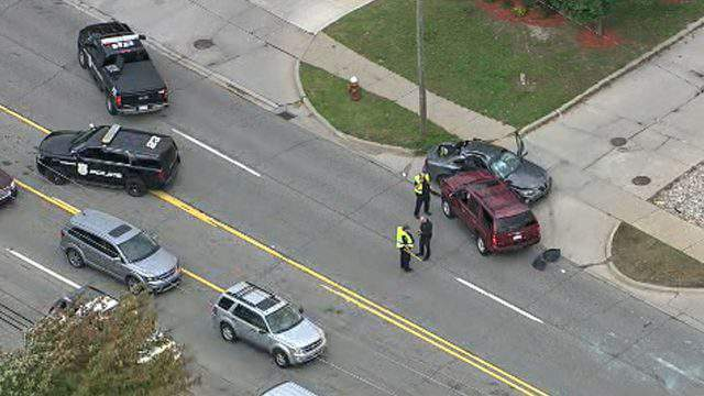 Police investigate a two-car collision on Chicago Road in Warren on Oct. 11, 2018. (WDIV)