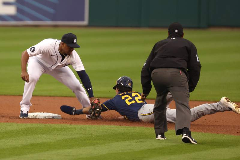 Jonathan Schoop #8 of the Detroit Tigers tags Christian Yelich #22 of the Milwaukee Brewers as he attempts to steal second base in the first inning at Comerica Park on September 08, 2020 in Detroit, Michigan.