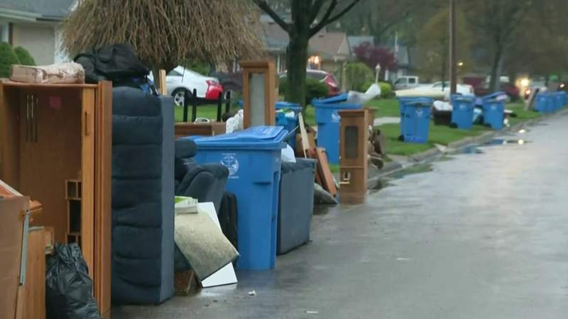 Damaged items line the curb in a Dearborn Heights neighborhod hit hard by flooding on May 1 and 2, 2019. (WDIV)