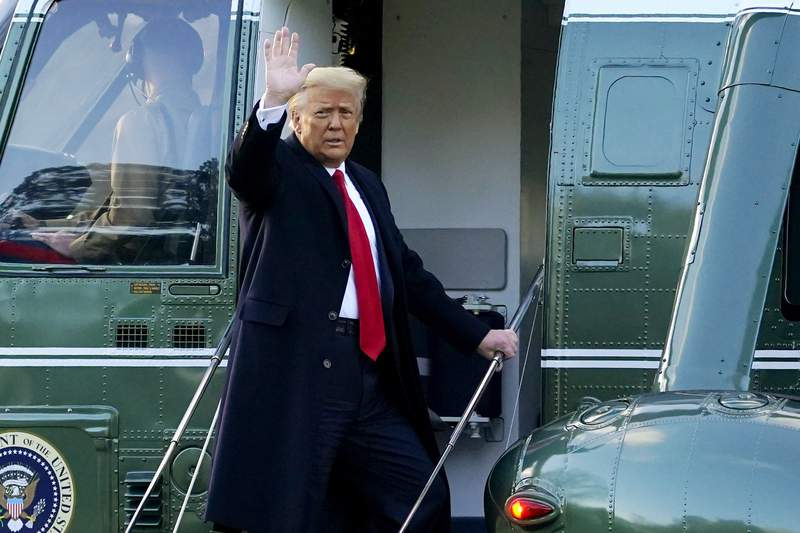 FILE - In this Wednesday, Jan. 20, 2021, file photo, President Donald Trump waves as he boards Marine One on the South Lawn of the White House, in Washington, en route to his Mar-a-Lago Florida Resort. (AP Photo/Alex Brandon, File)
