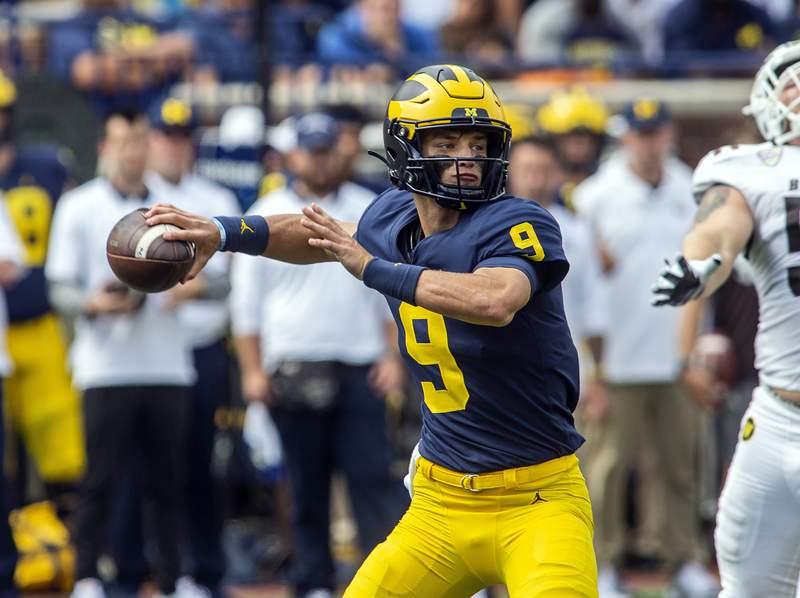 Michigan quarterback J.J. McCarthy (9) throws a pass in the third quarter of an NCAA college football game against Western Michigan in Ann Arbor, Mich., Saturday, Sept. 4, 2021.
