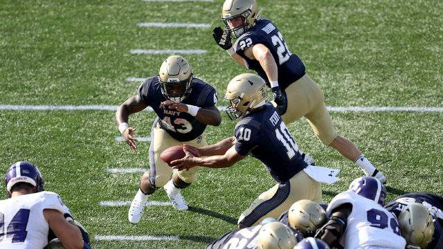 Fullback Nelson Smith #43 of the Navy Midshipmen takes a handoff from quarterback Malcolm Perry #10 to score against the Holy Cross Crusaders in the second half at Navy-Marine Corps Memorial Stadium on August 31, 2019 in Annapolis, Maryland. (Photo by Rob Carr/Getty Images)