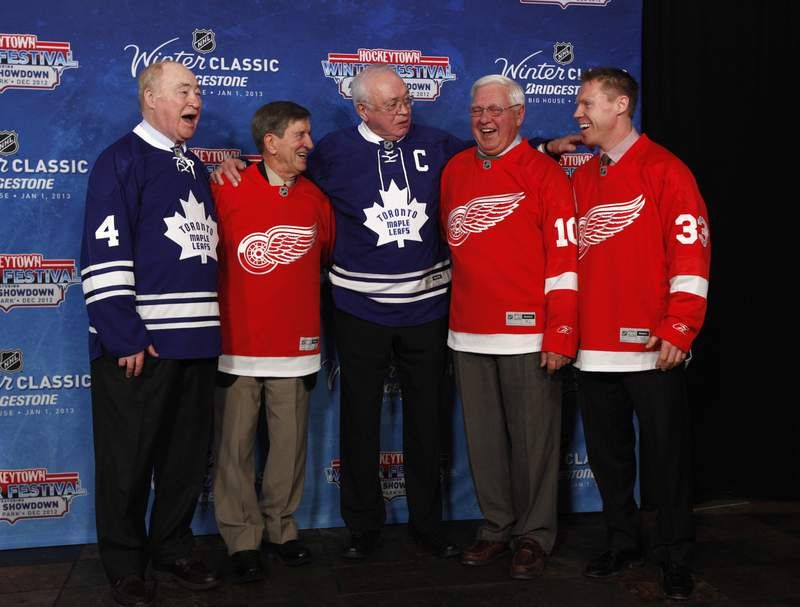 FILE - In this Feb. 9, 2012, file photo, National Hockey League alumni, from left to right, Red Kelly, Ted Lindsay, George Armstrong, Alex Delvecchio and Kris Draper pose during the announcement of the NHL Winter Classic hockey game at Comerica Park in Detroit. Armstrong, who captained the Maple Leafs to four Stanley Cups in the 60s and wore the blue and white his entire career, has died. He was 90. The Maple Leafs confirmed the death Sunday, Jan. 24, 2021, on Twitter. (AP Photo/Paul Sancya, File)