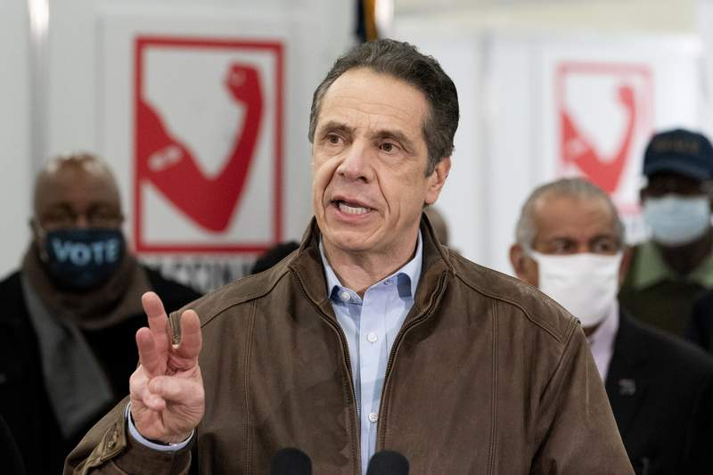 New York Gov. Andrew Cuomo speaks during a visit to a new COVID-19 vaccination site, Monday, March 15, 2021, at the State University of New York in Old Westbury, N.Y. Cuomo is facing calls for resignations from some members of his own party as most leading Democrats signal they want to await the results of the attorney generals investigation into claims the governor sexually harassed aides. (AP Photo/Mark Lennihan, Pool)