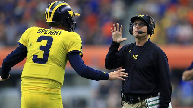 Michigan quarterback Wilton Speight talks to coach Jim Harbaugh during the team's win over Florida (Ronald Martinez/Getty Images).