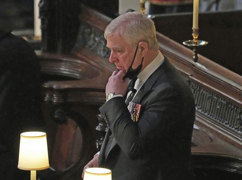 Britain's Prince Andrew inside St. Georges Chapel during the funeral of his father, Prince Philip, at Windsor Castle, Windsor, England, Saturday April 17, 2021. Prince Philip died April 9 at the age of 99 after 73 years of marriage to Britain's Queen Elizabeth II. (Yui Mok/Pool via AP)