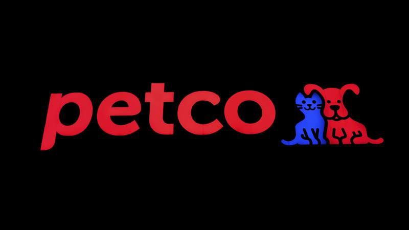 FILE - This Nov. 12, 2018 file photo hows a store sign at a Petco store in Chicago.  Petco, the San Diego-based pet store chain, went public again Thursday, Jan. 14, 2021 hoping to bank on peoples obsession with their furry friends.  Petcos stock, which opened at $18 Thursday, rose 66% to $29.89 in afternoon trading, valuing the company at more than $6 billion.   (AP Photo/Kiichiro Sato, File)