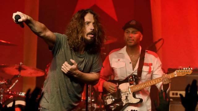Musicians Chris Cornell (L) and Tom Morello of Audioslave perform at Prophets of Rage and Friends' Anti Inaugural Ball at the Taragram Ballroom on January 20, 2017 in Los Angeles, California. (Photo by Kevin Winter/Getty Images)