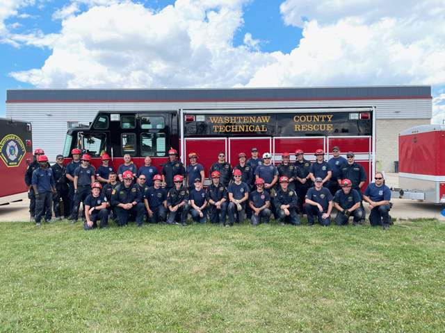 Washtenaw County firefighters pose for a photo at the Craig Sidelinger Fire Training Grounds on June 14, 2021.