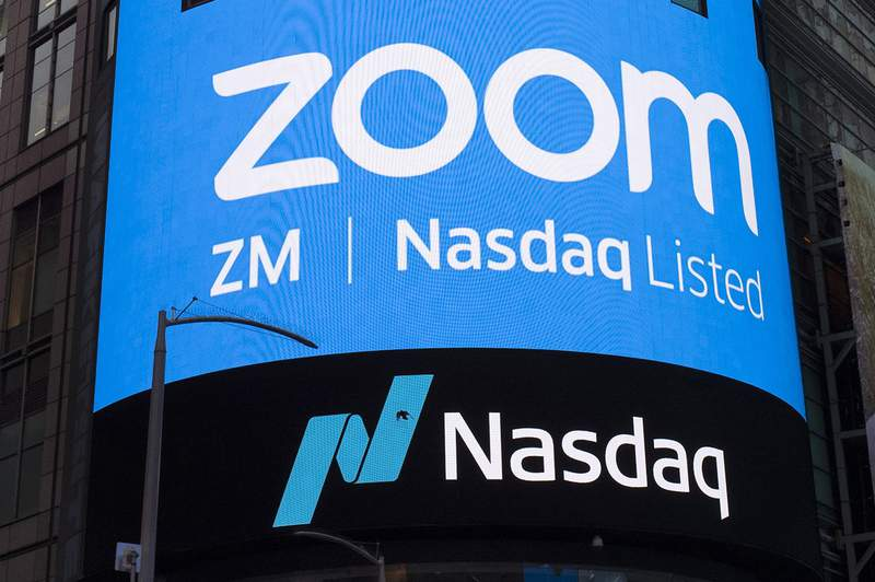 FILE - This April 18, 2019, file photo shows a sign for Zoom Video Communications ahead of their Nasdaq IPO in New York. Zoom is still booming, raising prospects that the video-conferencing service will be able to sustain its momentum, even as the easing pandemic lessens the need for virtual meetings. Some signs for optimism emerged in the companys latest quarterly earnings report released Tuesday, June 1, 2021, fueling a modest rally in the company's recently slumping stock. (AP Photo/Mark Lennihan, File)