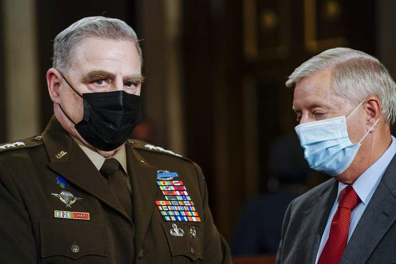 Joint Chiefs Chairman Gen. Mark Milley, left, and Sen. Lindsey Graham, R-S.C., talk as they arrive the chamber ahead of President Joe Biden speaking to a joint session of Congress, Wednesday, April 28, 2021, in the House Chamber at the U.S. Capitol in Washington. (Melina Mara/The Washington Post via AP, Pool)