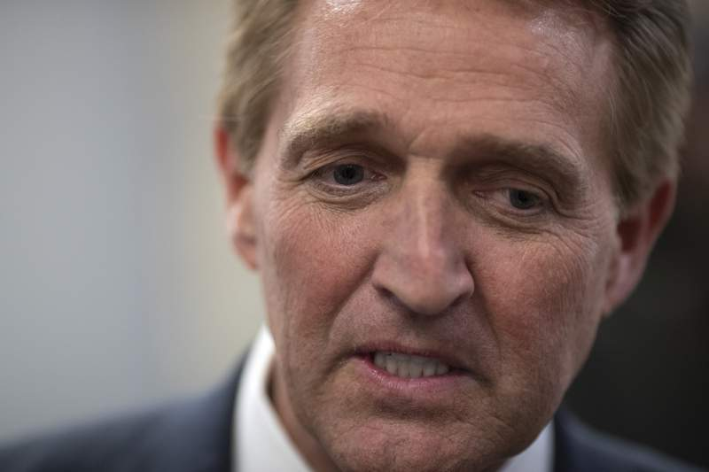 FILE - In this Nov. 14, 2018, file photo, then-Sen. Jeff Flake, R-Ariz., speaks with reporters at the Capitol in Washington. Republicans are facing a reckoning as they contend with some divisive candidates during the country's struggle through civic unrest. Hes driving away moderate Republicans and independents en masse, Flake, who retired last year after clashing with Trump, said in an interview Wednesday, June 3, 2020. For Republicans who need to appeal to a broader base, its devastating. (AP Photo/J. Scott Applewhite, File)