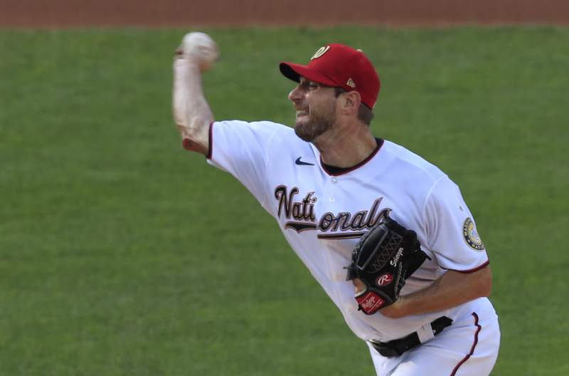 Washington Nationals starting pitcher Max Scherzer (31) throws during the first inning of a baseball game against the New York Mets in Washington, Wednesday, Aug. 5, 2020. (AP Photo/Manuel Balce Ceneta)