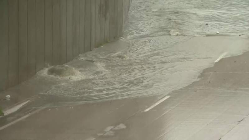 A drain contributing to a flooded Lodge Freeway at Jefferson Avenue on July 16, 2021.