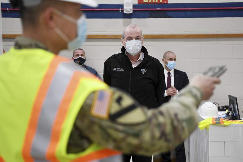 New Jersey Governor Phil Murphy visits an alternate care facility at New Bridge Bergen Medical Center in Paramus, N.J., on Wednesday, April 22, 2020. (Michael Karas/The Record via AP, Pool)