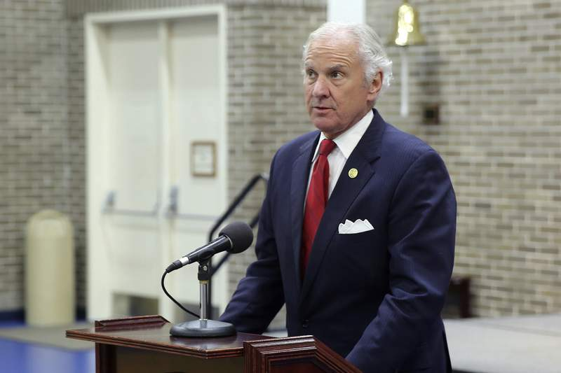 """FILE - In this Wednesday, Dec. 2, 2020 file photo, Gov. Henry McMaster gives a news conference in Columbia, S.C. McMaster, 73, has tested positive for the coronavirus and is slated to receive outpatient antibody treatment for mild symptoms."""" On Tuesday, Dec. 22, 2020, his office said that he learned he'd tested positive late Monday following a test due to coming into close contact with the COVID-19 virus."""" (AP Photo/Jeffrey Collins)"""