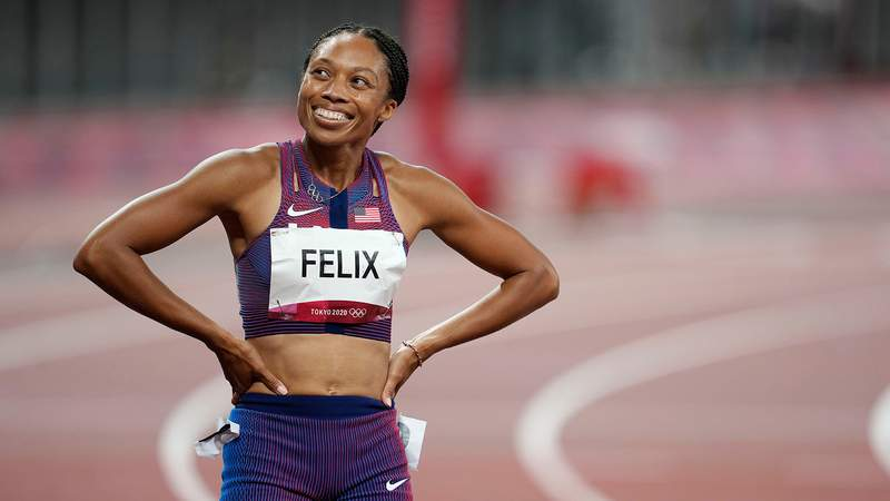 Aug 6, 2021; Tokyo, Japan; Bronze medalist Allyson Felix (USA) reacts after the women's 400m final during the Tokyo 2020 Summer Olympic Games at Olympic Stadium. Mandatory Credit: Andrew Nelles-USA TODAY Sports