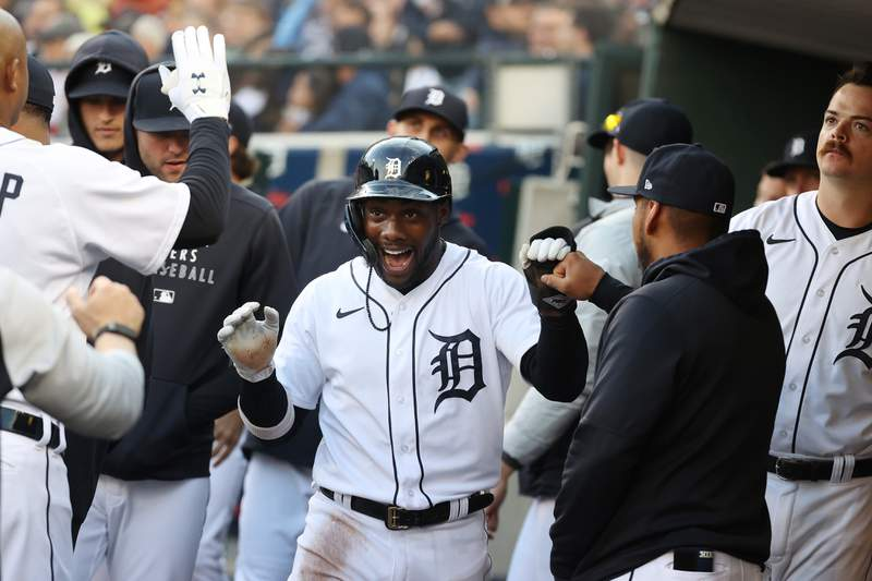 DETROIT, MICHIGAN - JUNE 22: Akil Baddoo #60 of the Detroit Tigers celebrates scoring a run in the fourth inning with teammates  while playing the St. Louis Cardinals at Comerica Park on June 22, 2021 in Detroit, Michigan. (Photo by Gregory Shamus/Getty Images)