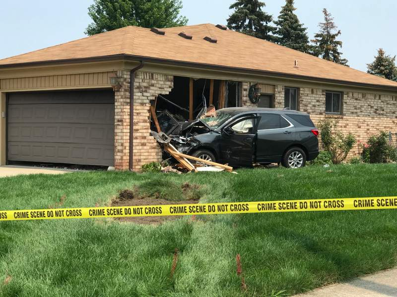 A car crashed into a house July 19, 2021, at Freeport Drive and 19 Mile Road in Sterling Heights.