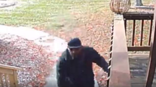 A man caught on camera stealing packages off a Clinton Township porch on Nov. 26, 2019.