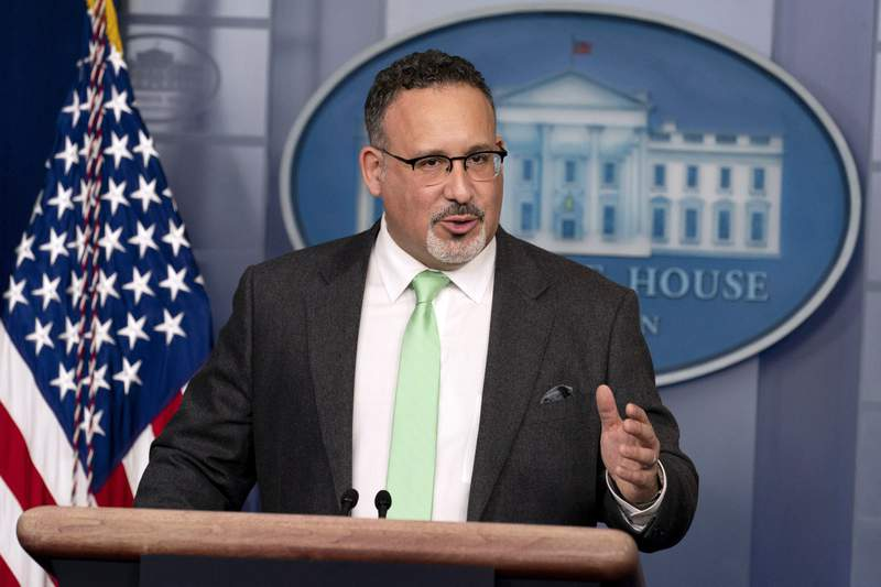 Education Secretary Miguel Cardona speaks during a press briefing at the White House, Wednesday, March 17, 2021, in Washington. (AP Photo/Andrew Harnik)