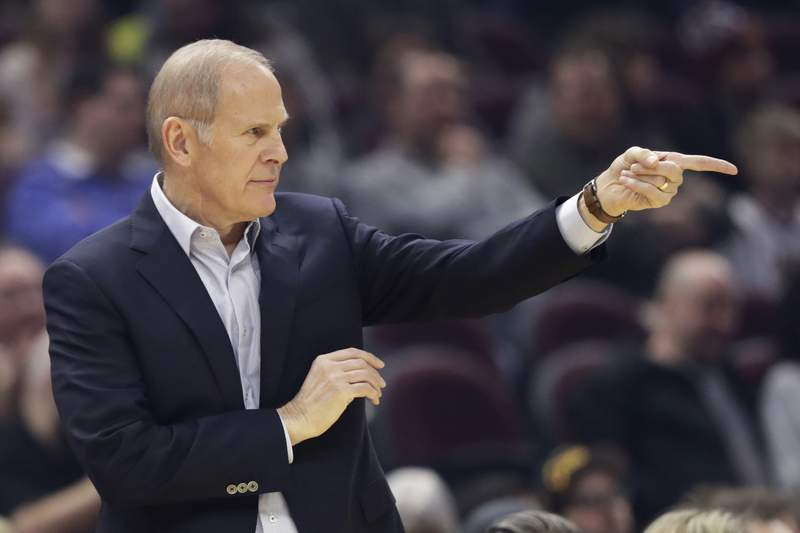 Cleveland Cavaliers coach John Beilein gives instructions to players during the first half of the team's NBA basketball game against the Toronto Raptors, Thursday, Jan. 30, 2020, in Cleveland. (AP Photo/Tony Dejak)