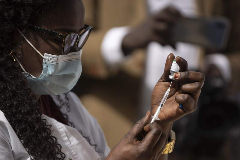 A health worker prepares a dose of the China's Sinopharm vaccine during the start of the vaccination campaign against the COVID-19 at the Health Ministry in Dakar, Senegal, Tuesday, Feb. 23, 2021. (AP Photo/Leo Correa)