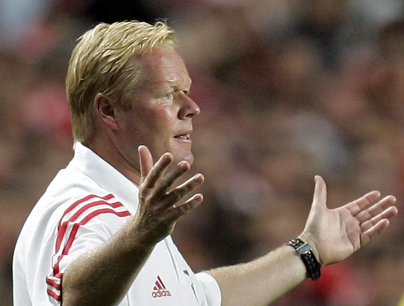 FILE - In this file photo dated Saturday, Aug. 6 2005, then Benfica's Dutch coach Ronal Koeman reacts during a friendly soccer match against Juventus, at Benfica's Luz stadium in Lisbon, Portugal.  Netherlands national coach, 57-year old Ronald Koeman underwent a heart procedure Sunday May 3, 2020, at a hospital in Amsterdam after feeling pain in his chest, his management company said in a statement. (AP Photo/Armando Franca, FILE)