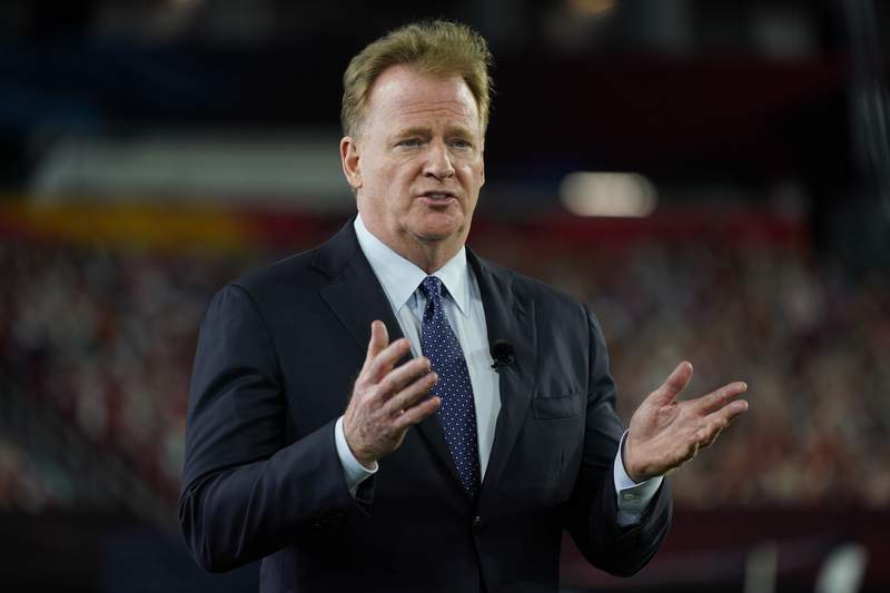 FILE - Commissioner Roger Goodell gestures during the NFL Honors ceremony as part of Super Bowl 55 in Tampa, Fla., in this Friday, Feb. 5, 2021, file photo. The NFL is increasing the regular season to 17 games, as expected, and reducing the preseason to three games. Team owners on Tuesday, March 30, 2021, approved the 17th game, marking the first time in 33 years the regular season has been increased.(AP Photo/Charlie Riedel, File)