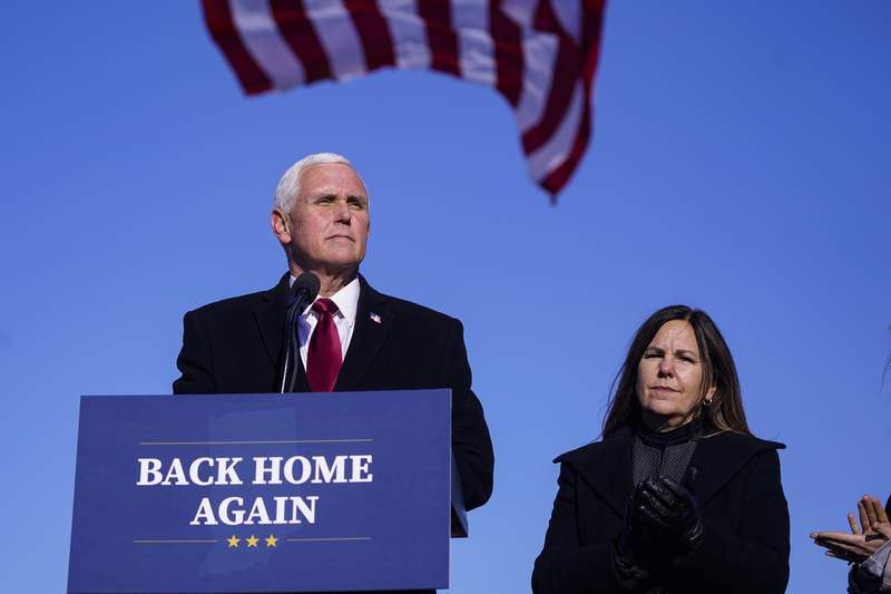 Former Vice President Mike Pence speaks after arriving back in his hometown of Columbus, Ind., Wednesday, Jan. 20, 2021. Pence has returned to his Indiana hometown, where he told a small crowd that serving in the White House was the greatest honor of his life. Pence flew on a government plane Wednesday afternoon into the Columbus Municipal Airport with his wife, Karen, after attending President Joe Bidens inauguration. (AP Photo/Michael Conroy)
