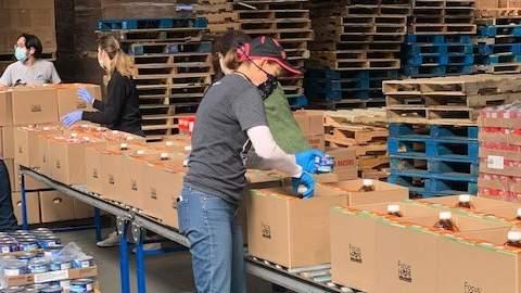 Volunteers packaging donations