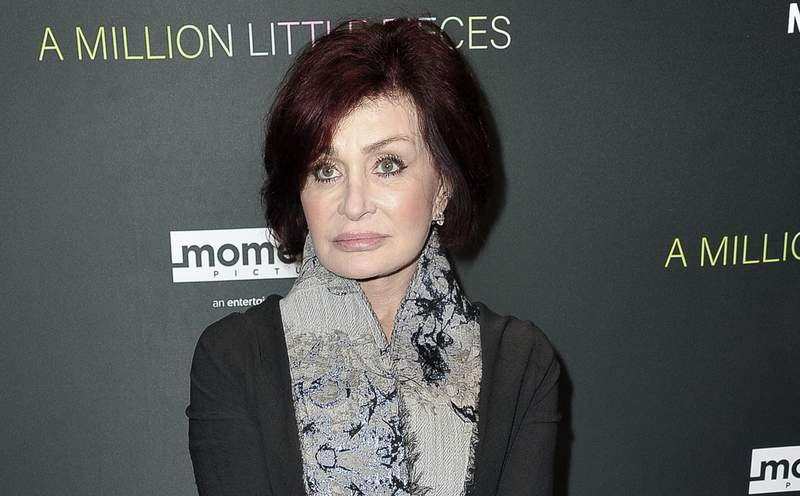 """FILE - Sharon Osbourne attends a special screening of """"A Million Little Pieces"""" on Dec. 4, 2019, in Los Angeles. CBS says its daytime show """"The Talk"""" will stay on hiatus for another week after a discussion about racism involving co-host Sharon Osbourne went off the rails last week. Osbourne reacted with anger and profanity when asked to talk about her support and friendship with British TV personality Piers Morgan. (Photo by Richard Shotwell/Invision/AP, File)"""