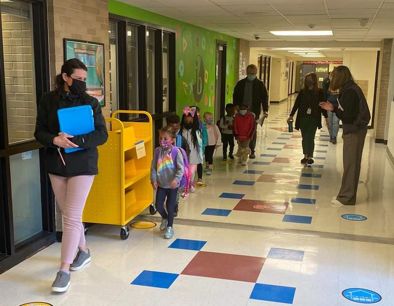 Preschoolers arrive to school in Ann Arbor on March 25, 2021.