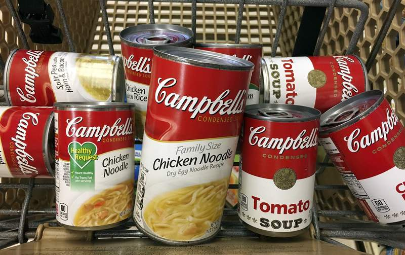 FILE - This May 23, 2017, file photo shows a variety of Campbell's soups in a grocery cart at a store in Phoenix. Campbell Soup reported strong fiscal fourth-quarter earnings on Thursday, Sept. 3, 2020 boosted by people making more food at home because of the coronavirus pandemic. (AP Photo/Ross D. Franklin, File)