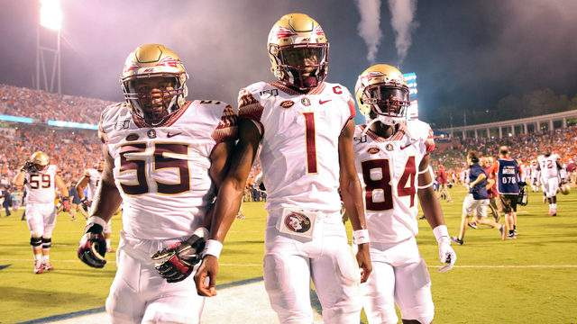 James Blackman #1 of the Florida State Seminoles walks off the field between Dontae Lucas #55 and Adarius Dent #84 after the end of a game against the Virginia Cavaliers at Scott Stadium on September 14, 2019 in Charlottesville, Virginia. (Photo by Ryan M. Kelly/Getty Images)