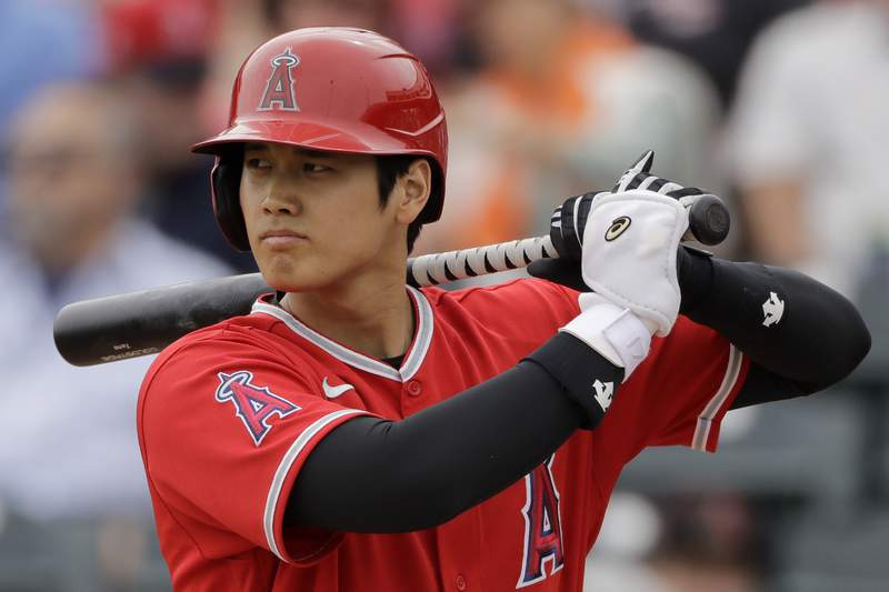 FILE - In this  Friday, Feb. 28, 2020 file photo, Los Angeles Angels' Shohei Ohtani bats during the first inning of a spring training baseball game against the Texas Rangers in Tempe, Ariz. Angels general manager Billy Eppler confirmed Tuesday, June 30, 2020 that Japanese star Shohei Ohtani will pitch and hit in the majors this season.(AP Photo/Charlie Riedel, File)