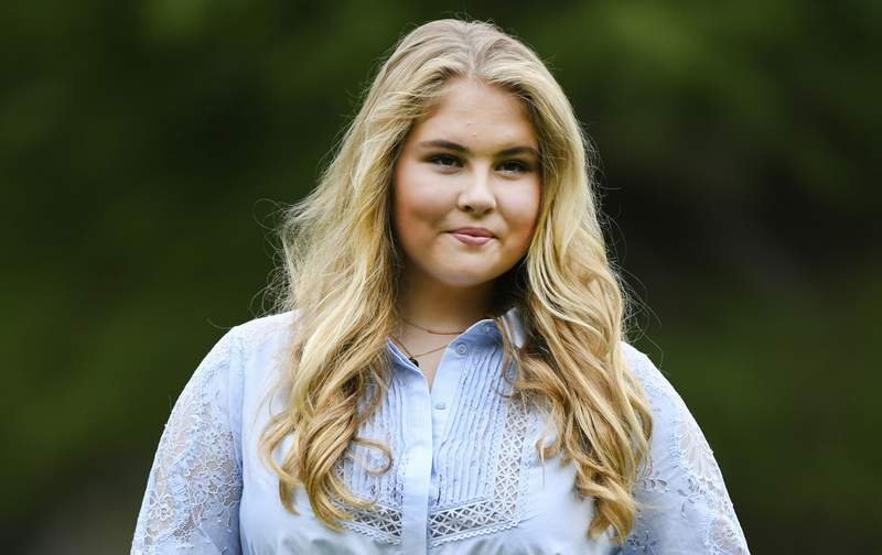 FILE - In this Friday, July 17, 2020 file photo, Netherlands' Princess Amalia poses in the garden of royal palace Huis ten Bosch in The Hague, Netherlands, during an official photo session at the start of the summer holiday. A man who sent death threats to the Dutch king's eldest daughter was sentenced Tuesday, Nov. 3, 2020 to three months imprisonment and ordered to undergo psychiatric treatment. (Piroschka van de Wouw, Pool via AP, File)