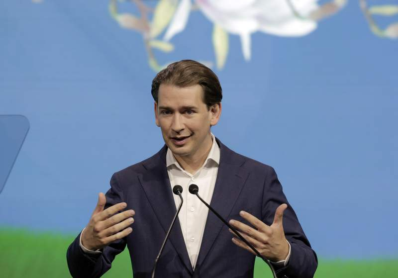 """FILE - In this Thursday, July 1, 2021 file photo, Austrian Chancellor Sebastian Kurz talks at the """"Austrian World Summit"""" about the visions and actions to fight the climate crisis in Vienna, Austria. Austrias conservative Peoples Party has voted overwhelmingly to reelect Chancellor Sebastian Kurz as its leader at a party gathering, it was announced Saturday, Aug. 28. Kurz, 35, received the backing of 533 of 536 delegates, or 99.4%. (AP Photo/Lisa Leutner, file)"""