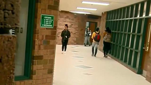Students walking in the hall at Novi High School. (WDIV)