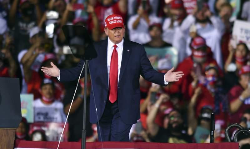 President Donald Trump arrives at his campaign rally at Opa-Locka Executive Airport, late Sunday, Nov. 1, 2020, in Opa-Locka, Fla. (AP Photo/Jim Rassol)