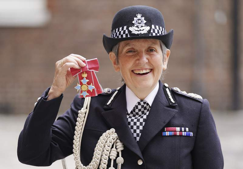 FILE - In this Wednesday July 14, 2021 file photo, Britain's Metropolitan Police Commissioner Cressida Dick poses for her photo after she was made a Dame Commander of the Order of the British Empire, at St James's Palace in central London. The British government on Friday, Sept, 10 says the country's most senior police officer will stay in her job for another two years. Metropolitan Police Commissioner Cressida Dick will remain at the helm of the London force until April 2024. (Kirsty O'Connor/Pool Photo via AP, file)